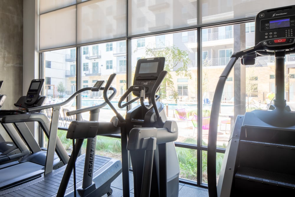 Fitness center with city views at  in San Antonio,TX