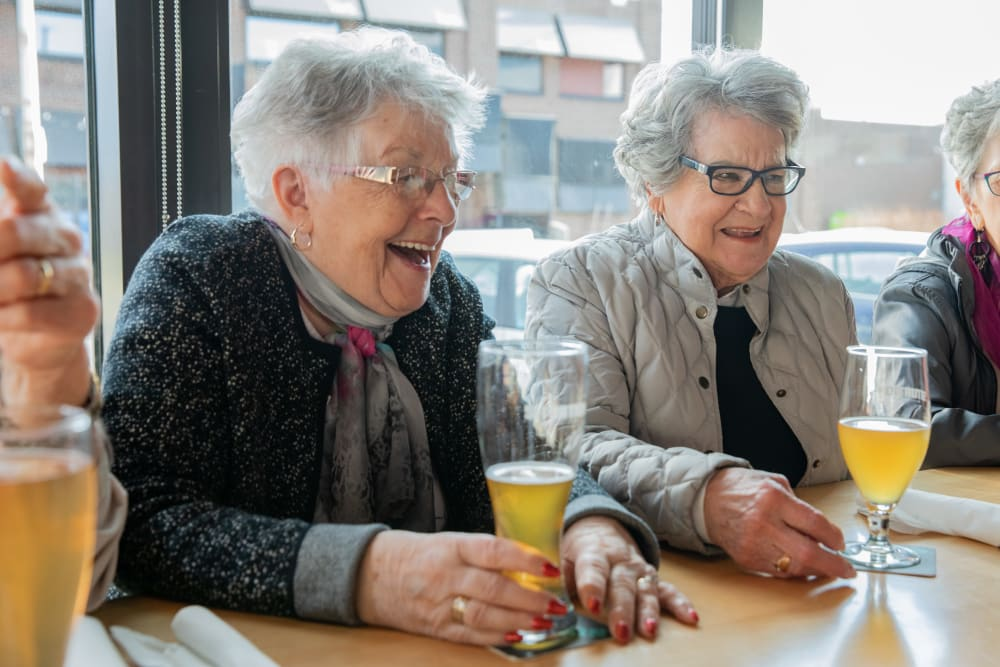 women laughing during brunch at Touchmark at Wedgewood in Edmonton, Alberta