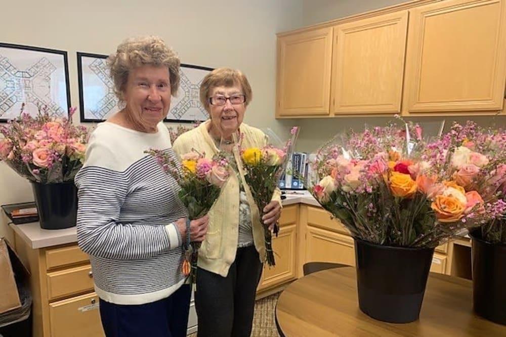 Residents with flowers at Merrill Gardens at Oceanside in Oceanside, California.