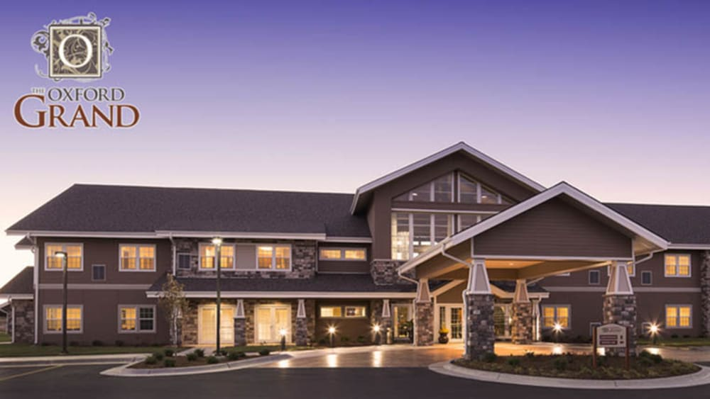 Front entrance of The Oxford Grand Assisted Living & Memory Care at dusk in Wichita, Kansas
