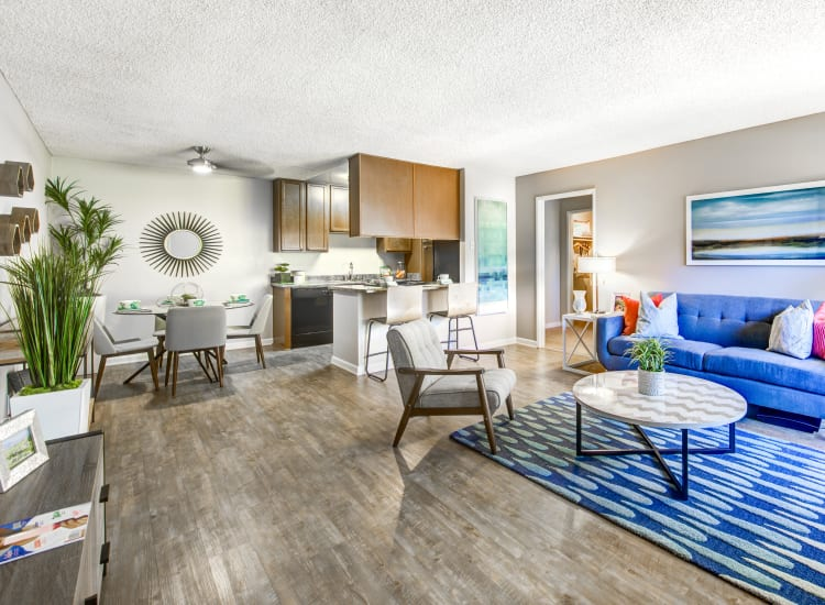 Large, well-furnished open-concept floor plan in a model home at Sofi Poway in Poway, California