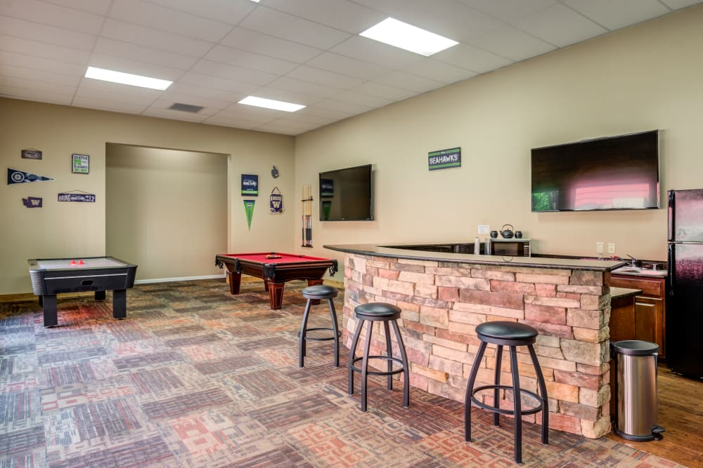 Clubhouse kitchen and game tables at Chestnut Hills Apartments in Puyallup, WA