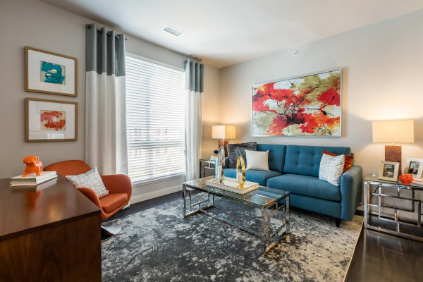 Open floor plan furnished Living room at Strata Apartments in Denver, Colorado