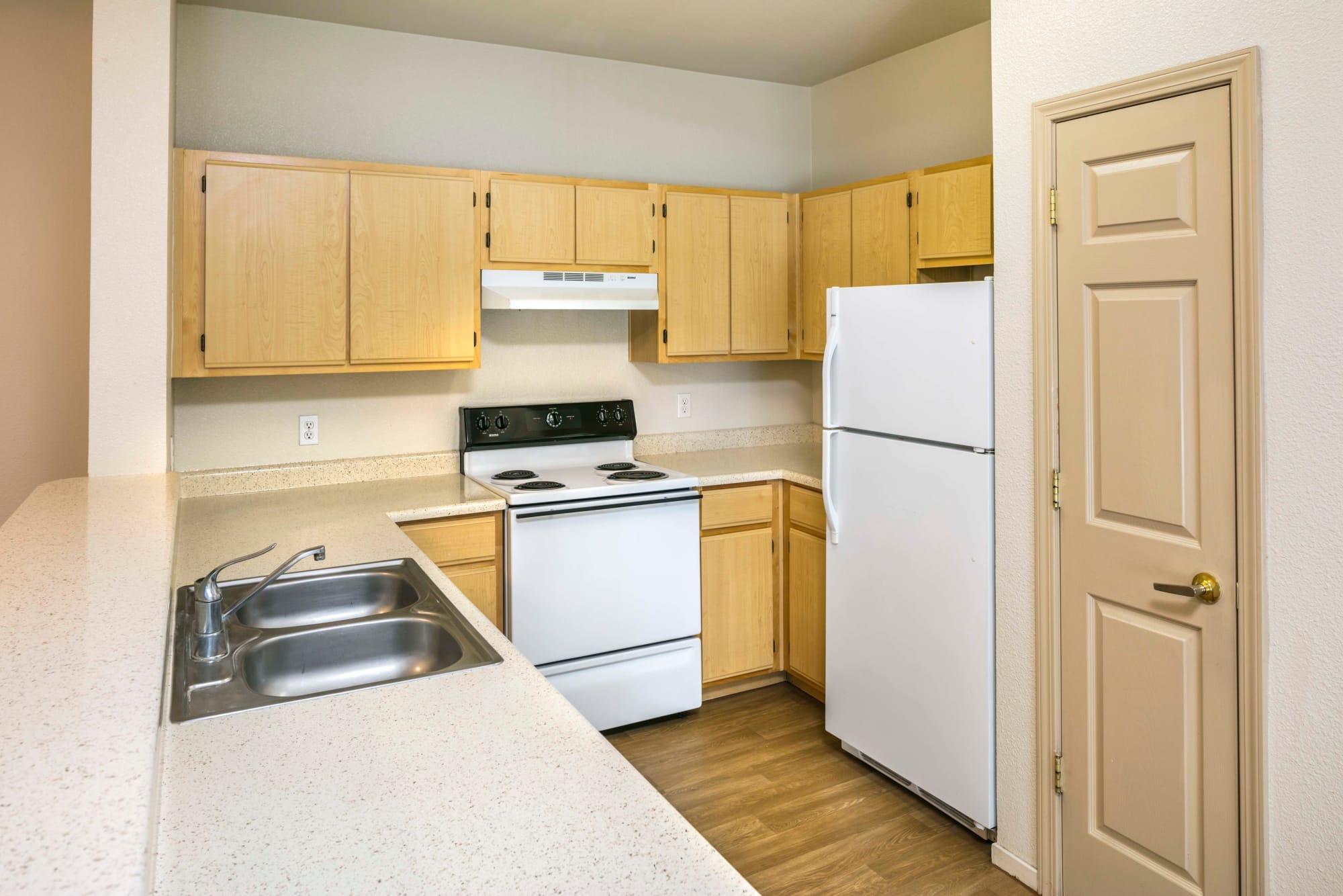 A full kitchen at Natomas Park Apartments in Sacramento, California
