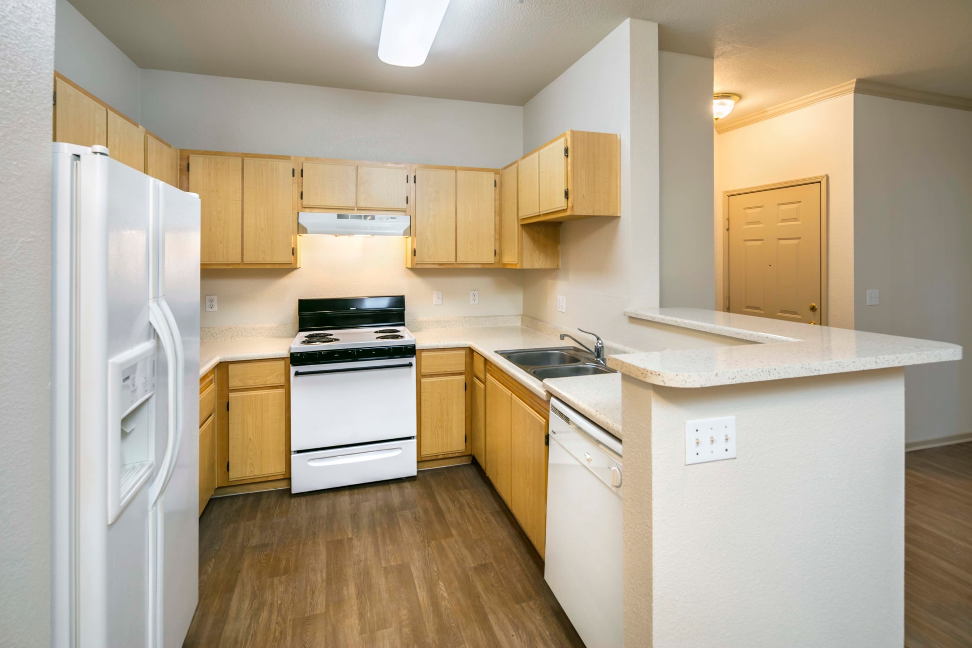 A kitchen layout at Natomas Park Apartments in Sacramento, California