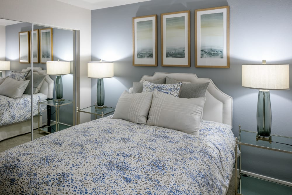 Model bedroom with unique accent lighting at The Carriages at Fairwood Downs in Renton, Washington