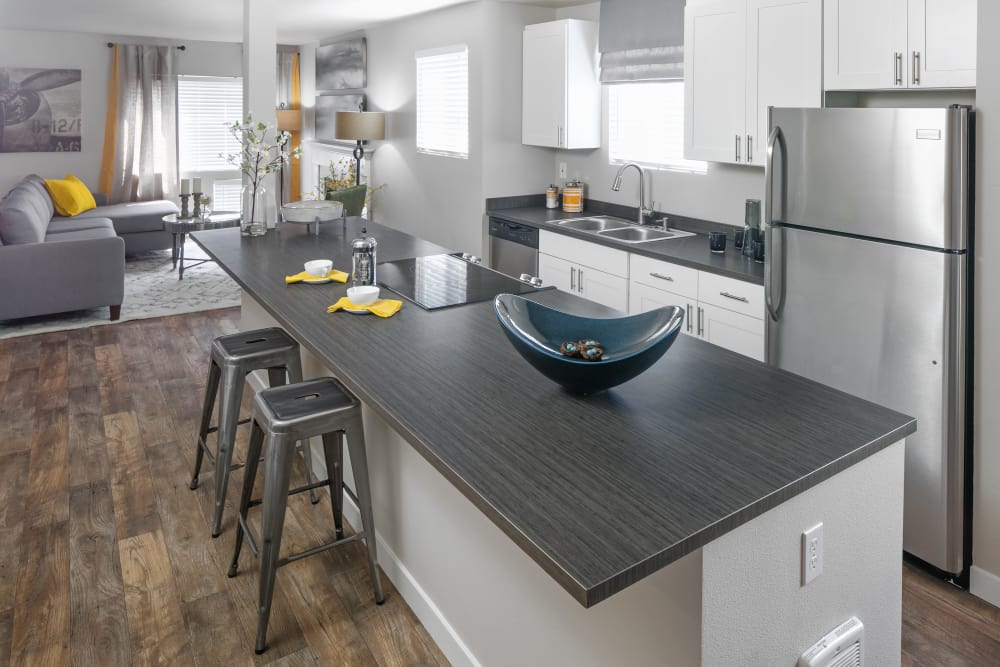 Modern kitchen with white cabinetry at The Carriages at Fairwood Downs in Renton, Washington