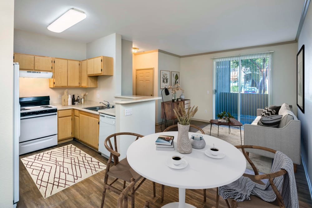 An open dining room and kitchen at Natomas Park Apartments in Sacramento, California