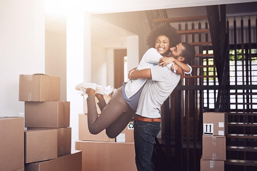 Couple unpacking in their new apartment in Thibodaux, Louisiana