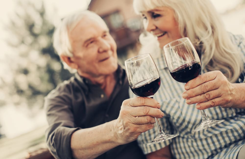 Resident couple toasting to their decision to live at Carmel Village in Fountain Valley, California