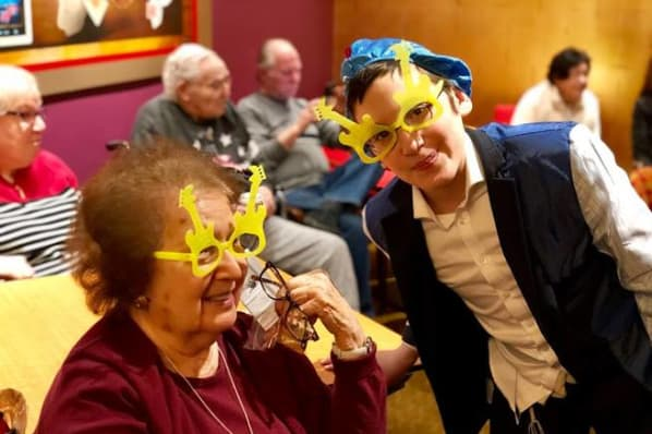 Residents at All Seasons of West Bloomfield in West Bloomfield, MI having a celebration