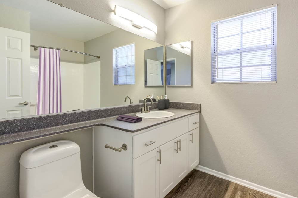 Bathroom with a large mirror at Village Oaks in Chino Hills, California