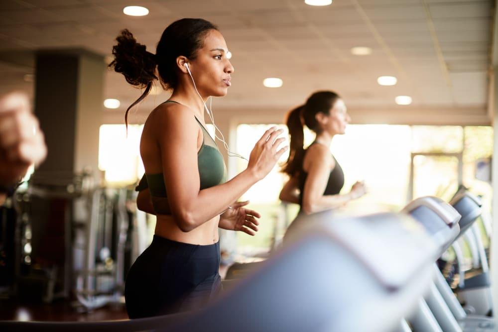 Resident running at her community gym at Manassas Station Apartments in Manassas, Virginia