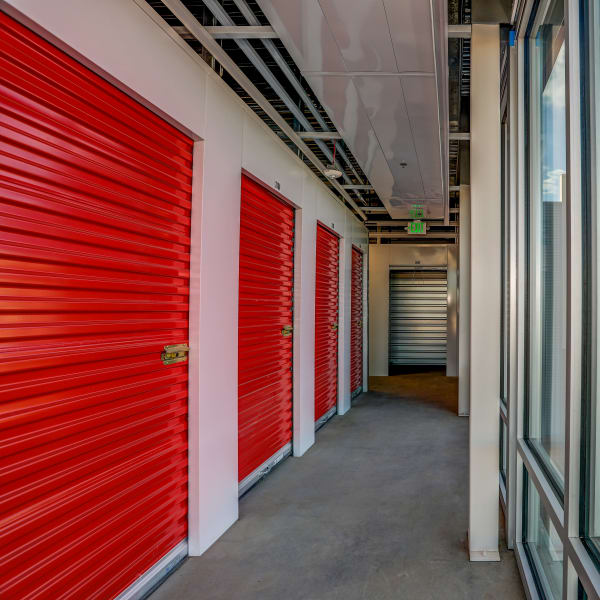 Interior units with red doors at StorQuest Self Storage in Lakewood, Colorado