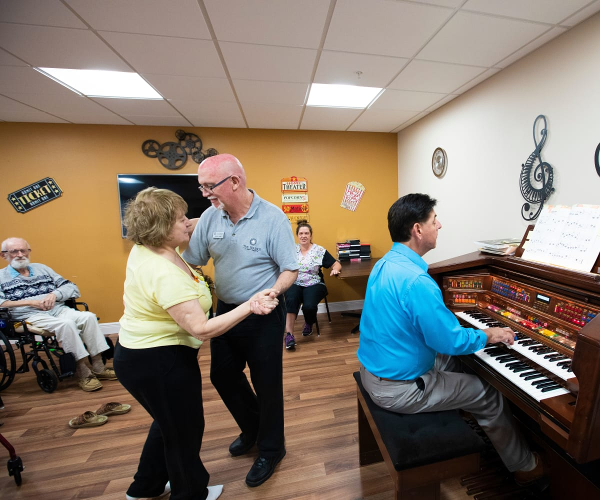 Residents enjoy music and dancing at The Springs At South Biscayne in North Port, Florida.