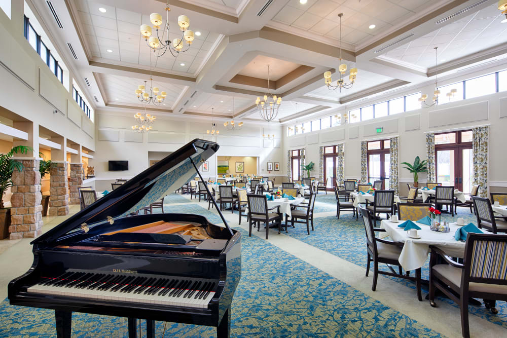 Beautiful dining room with piano at The Fountains of Hope in Sarasota, Florida.