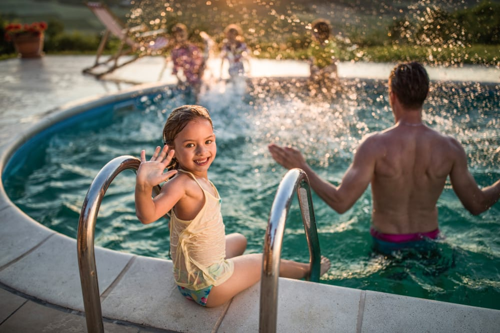 Family enjoying the resort-inspired swimming pool at Mezza in Jacksonville, Florida
