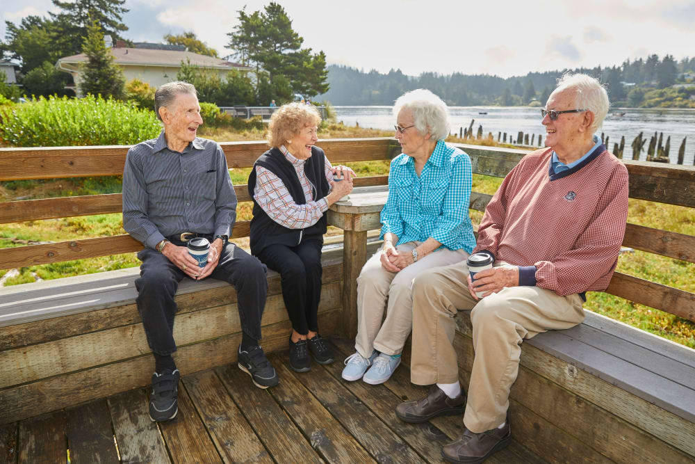 Shorewood Senior Living group of friends talking outside in Florence, Oregon