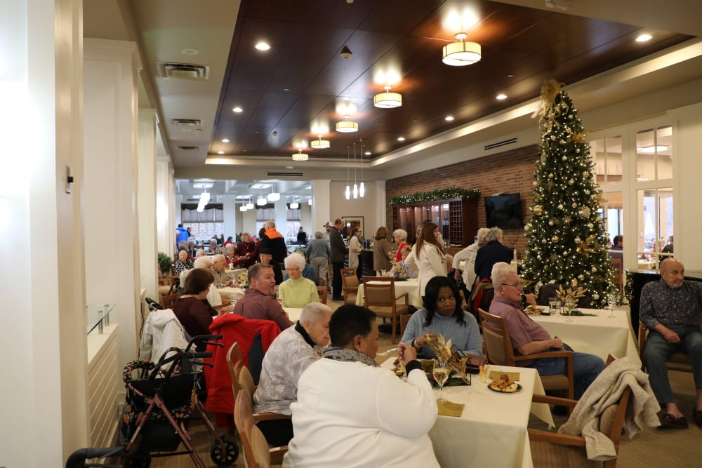 Residents and family members gathered in the dining room at Merrill Gardens at Madison in Madison, Alabama.