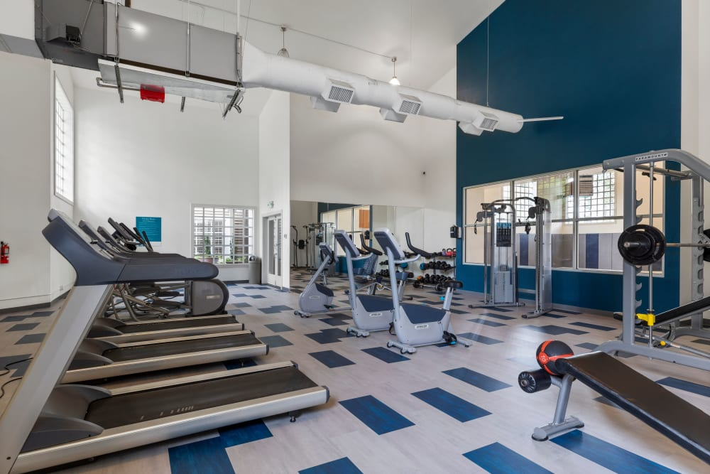 Fitness center with plenty of individual workout stations at Olin Fields Apartments in Everett, Washington