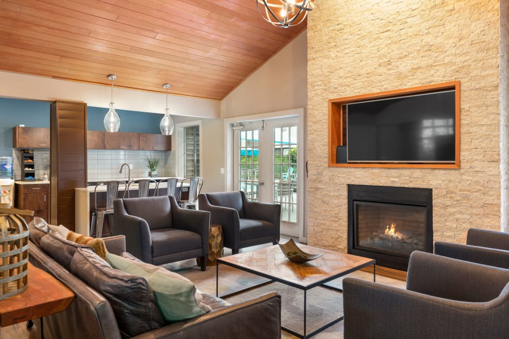 Community common area with a fireplace for resident use at Olin Fields Apartments in Everett, Washington