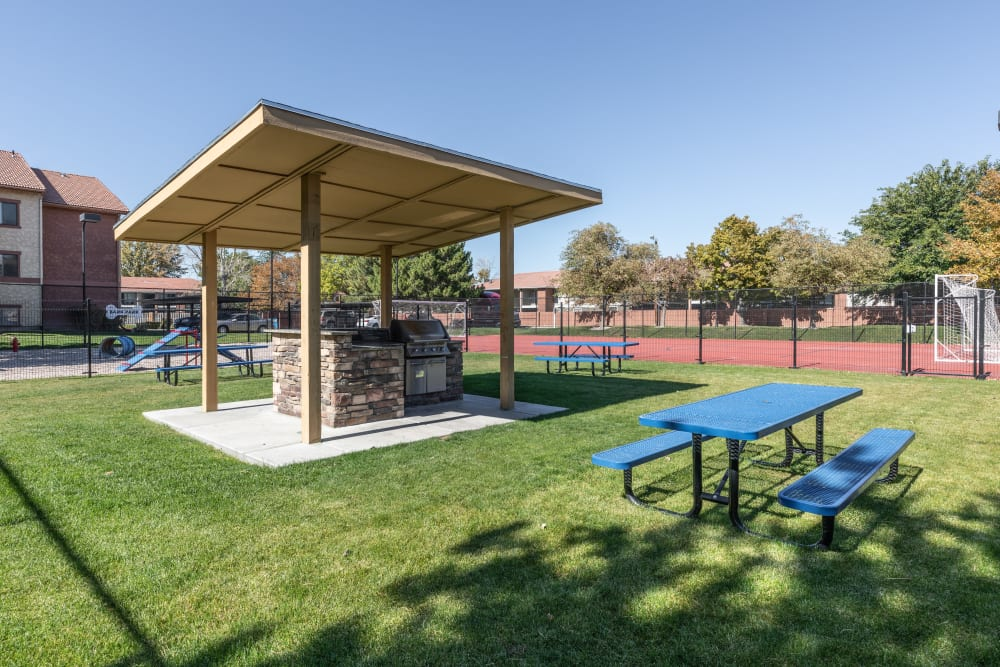 Picnic and barbecue area at Shadowbrook Apartments in West Valley City, Utah