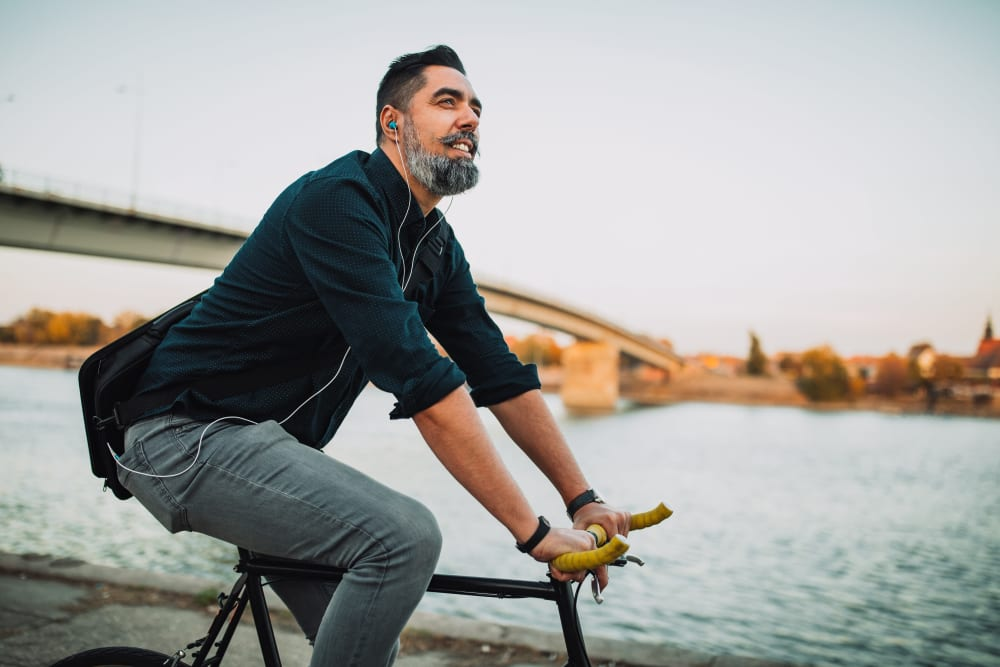 A man on a bike ride near The Columbia at the Waterfront in Vancouver, Washington