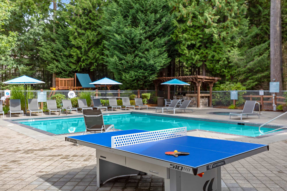 Ping pong table by the beautiful resort-style swimming pool at Wildreed Apartments in Everett, Washington