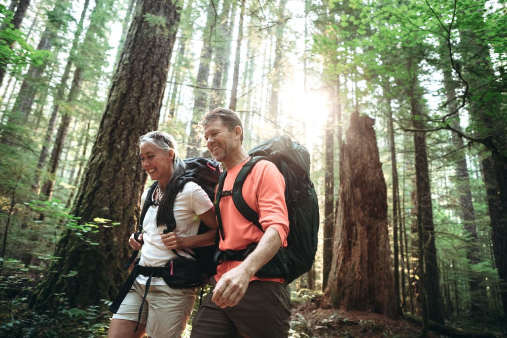 A couple on a hike near Newport Crossing Apartments in Newcastle, Washington