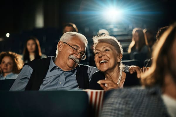 Couple watching a movie at the theater near The Pointe at Siena Ridge in Davenport, Florida