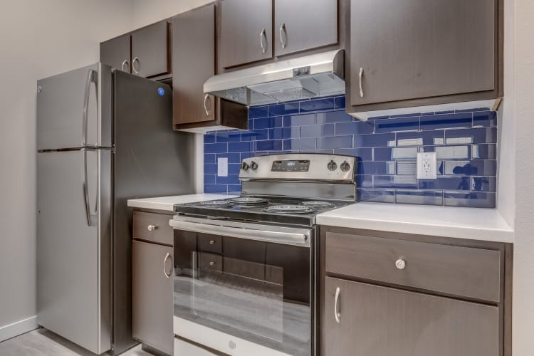 Fully equipped kitchen with stainless-steel appliances at Lumen Apartments in Everett, Washington