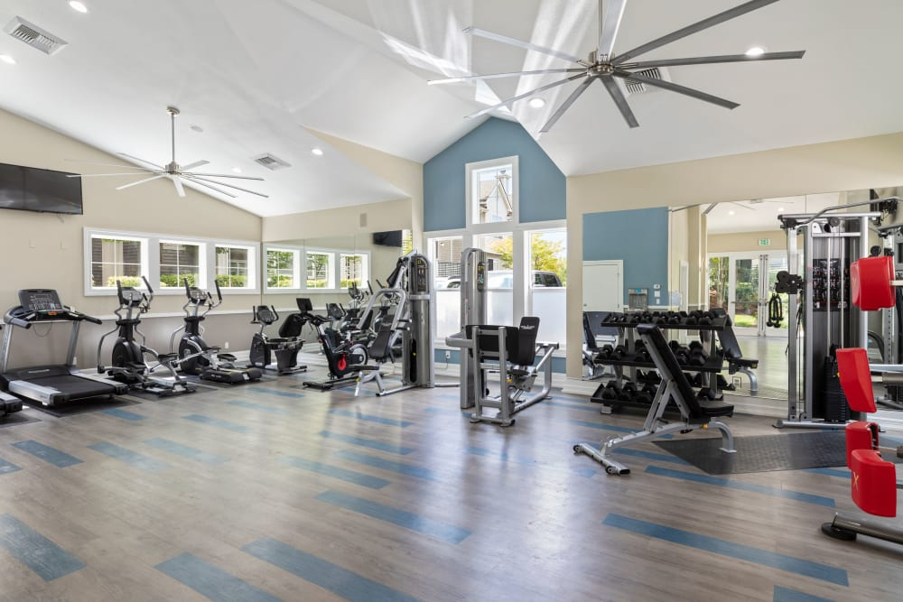 Clean, modern community gym at HighGrove Apartments in Everett, Washington