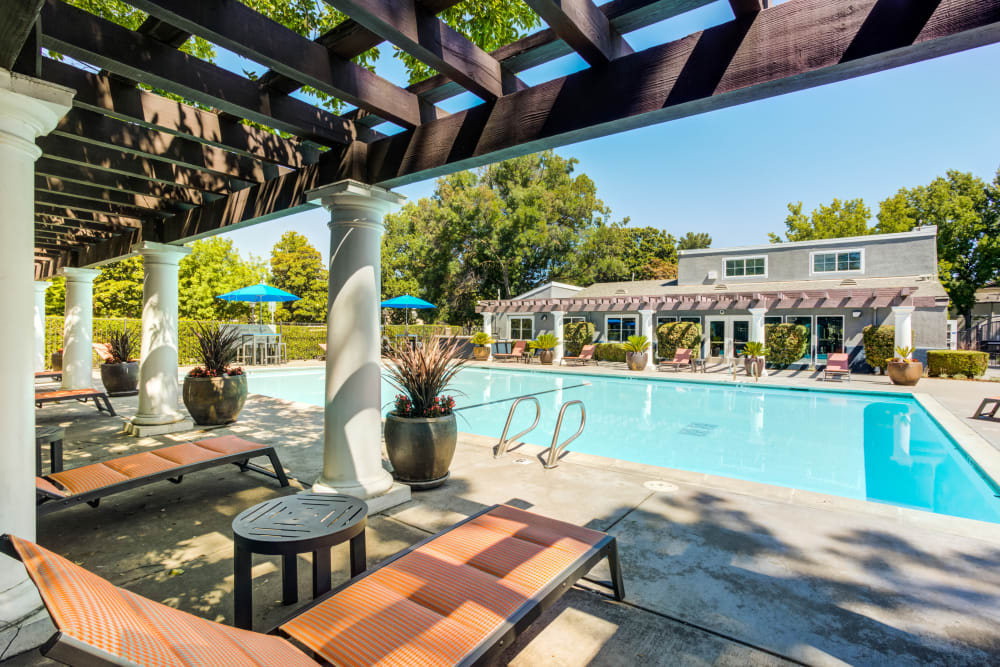 Beautiful resort-style swimming pool and hot tub at The Woodlands Apartments in Sacramento, California