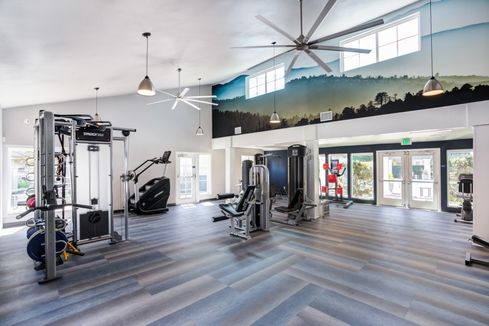 Fitness center with plenty of individual workout stations at The Woodlands Apartments in Sacramento, California