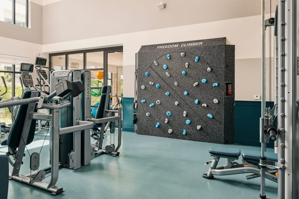 Gym with climbing wall at The Copeland in Austin, Texas