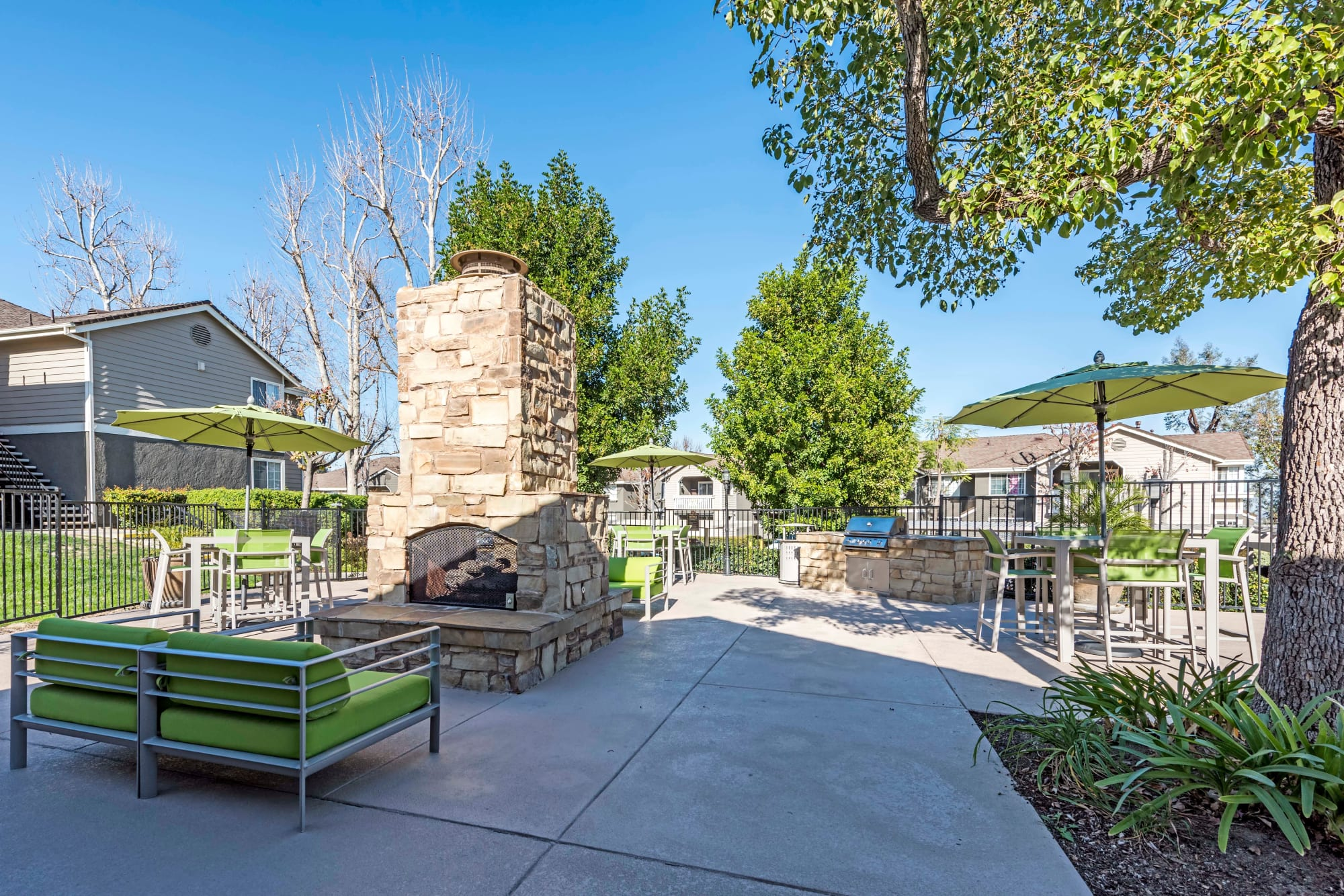 Outdoor fire pit lounge area at Village Oaks in Chino Hills, California