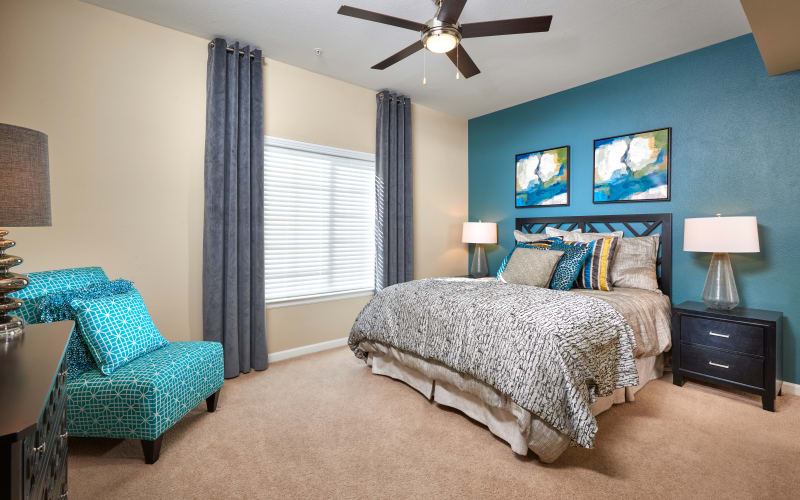 Large master bedroom with a ceiling fan at Skyecrest Apartments in Lakewood, Colorado