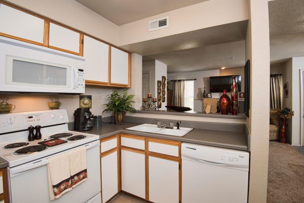 Kitchen with white appliances at Crown Chase Apartments in Wichita, Kansas