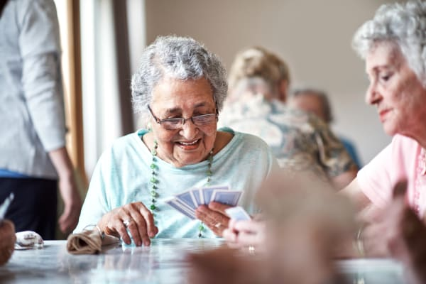 Residents playing cards at Alderbrook Village in Arkansas City, Kansas.
