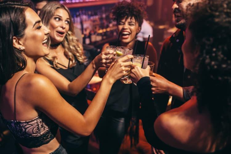 Friends enjoying drinks in Las Vegas, NV near Trend!