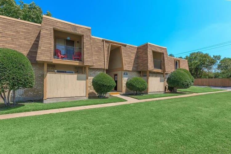Exterior with large lawn at The Manchester Apartments in Euless, Texas