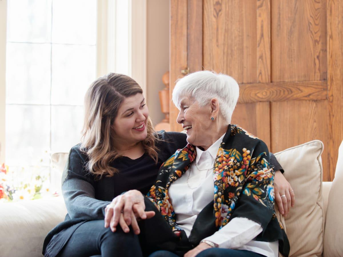 A resident and a younger family member embracing at Ativo Senior Living of Yuma in Yuma, Arizona.