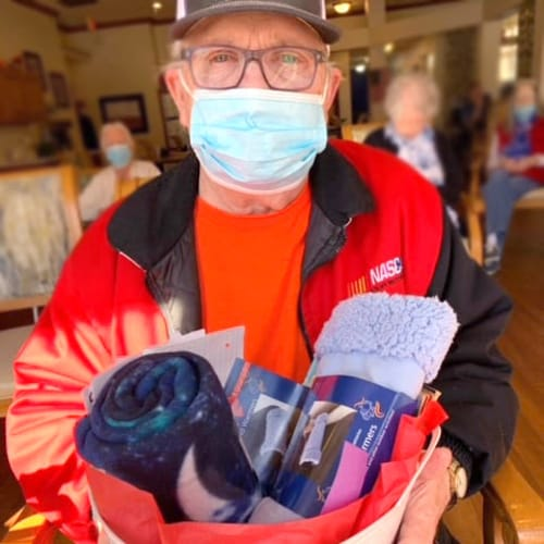 A resident with a collection of gifts at Ashbrook Village in Duncan, Oklahoma