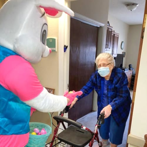 Resident being visited by the Easter Bunny delivering chocolate at Madison House in Norfolk, Nebraska