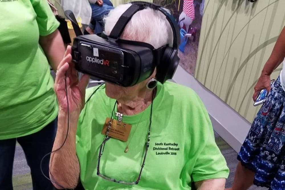 A resident from The Willows at Harrodsburg in Harrodsburg, Kentucky testing a Virtual Reality headset