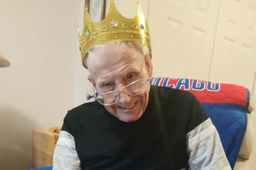 A happy resident with a crown on at Brentwood at Hobart in Hobart, Indiana