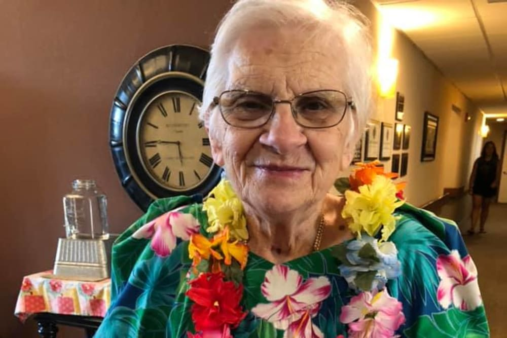 A resident with a Hawaiian lei on at Villas of Holly Brook Effingham in Effingham, Illinois