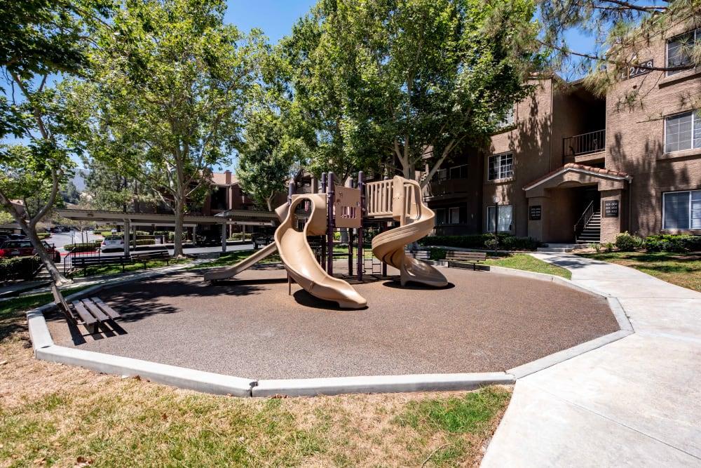 Children's playground at Sierra Del Oro Apartments in Corona, California