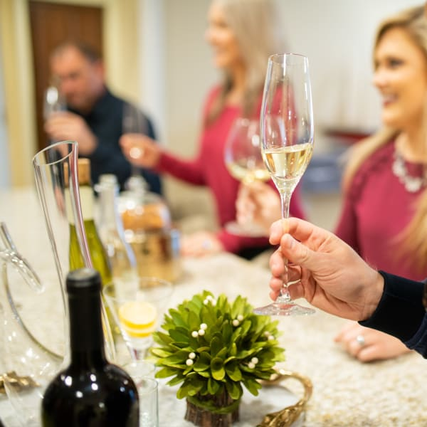 Resident's enjoying a glass of wine together at San Palmas in Chandler, Arizona