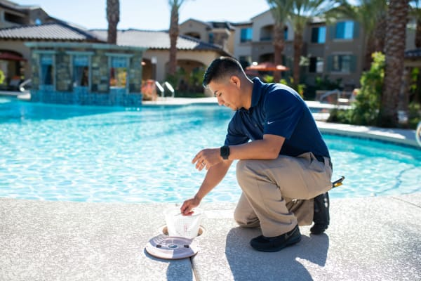 Mark-Taylor employee servicing the pool at one of our communities